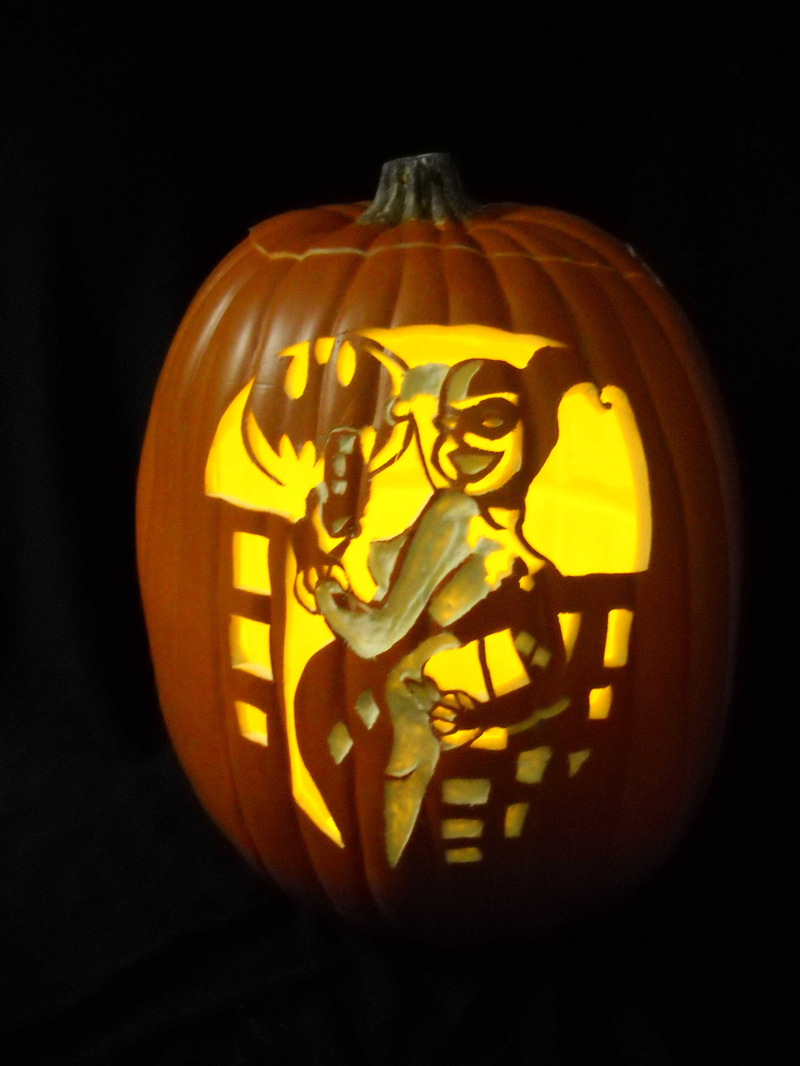 Pumpkin carving harley quinn based on the art of